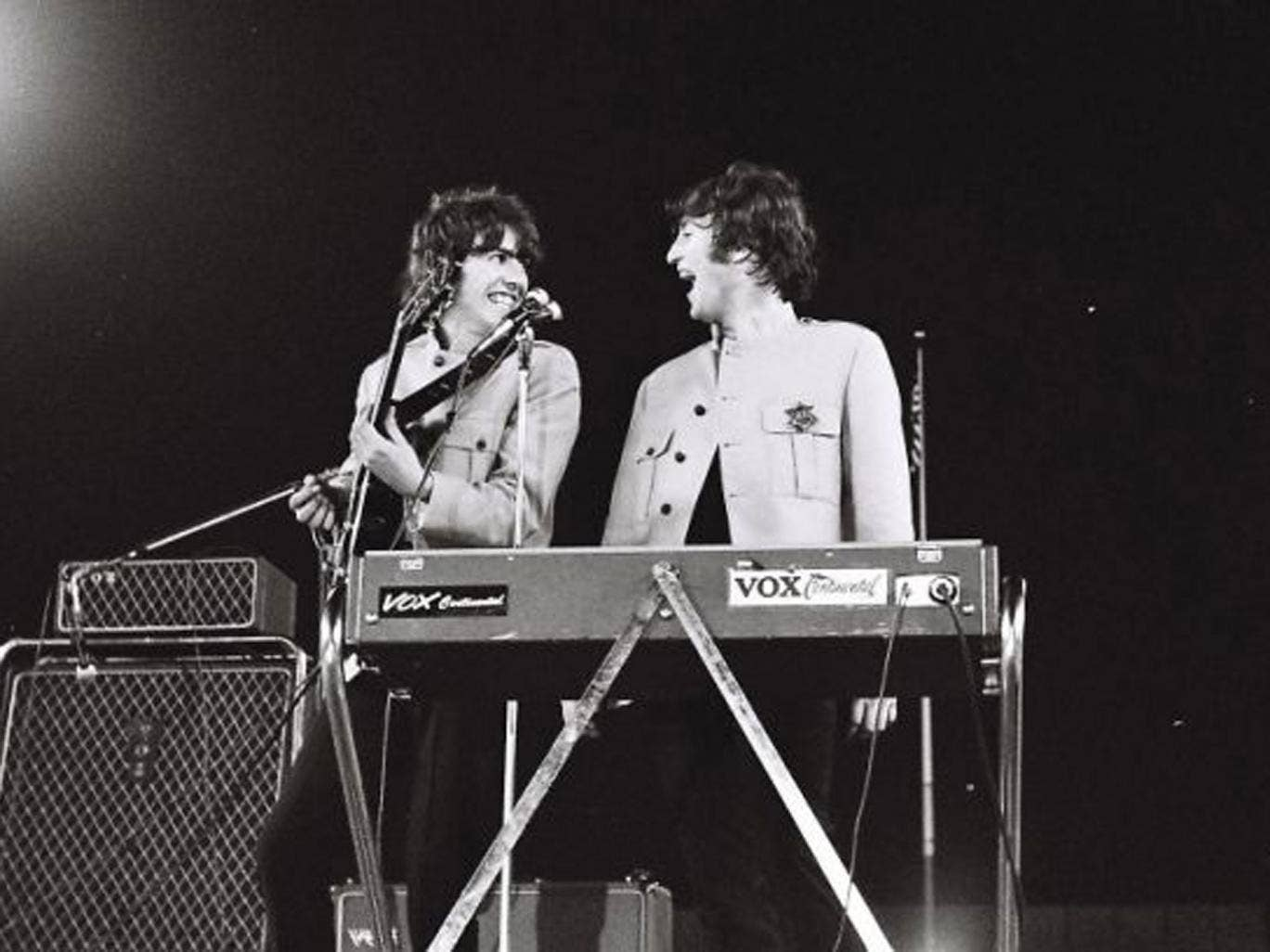 Handout photo issued by Omega Auctions of George Harrison (left) and John Lennon during The Beatles iconic Shea Stadium performance in August 1965 in New York
