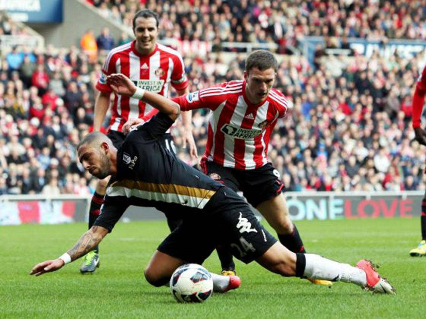 Sunderland's Craig Gardner fouls Fulham's Ashkan Dejagah to concede a penalty during Saturday's Premier League game