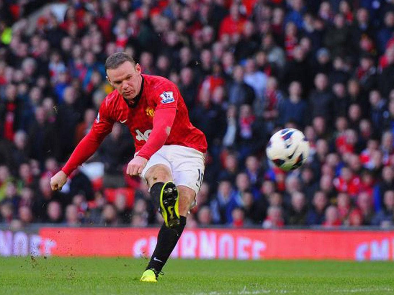 Wayne Rooney shoots to score United's fourth goal against Norwich