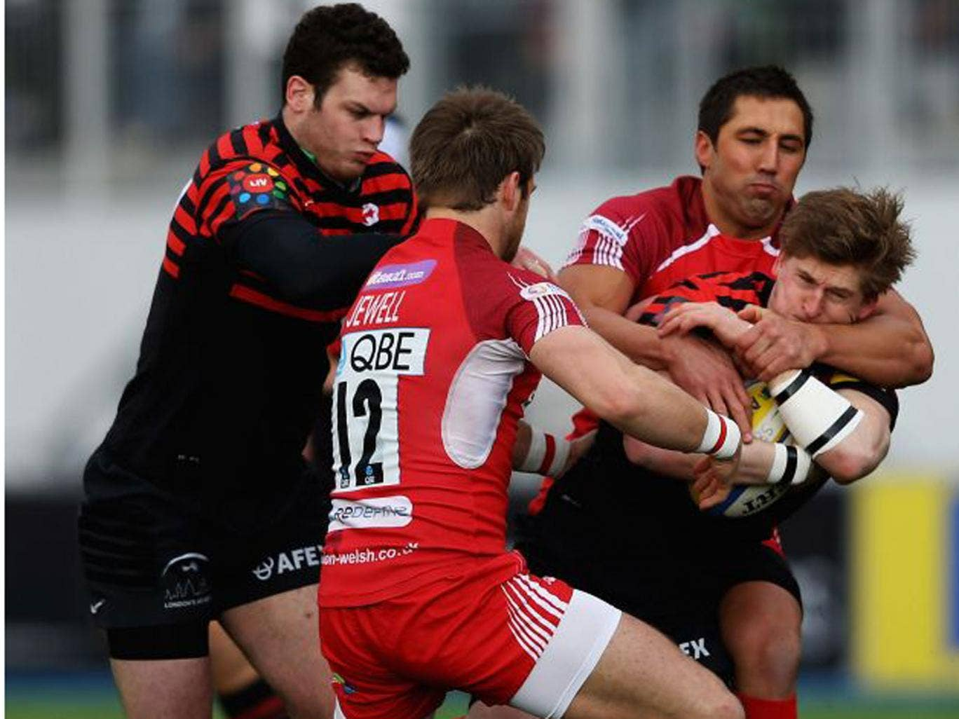 Gavin Henson, of London Welsh, ensures there is no way through for Saracens' tryscorer David Strettle this timeG