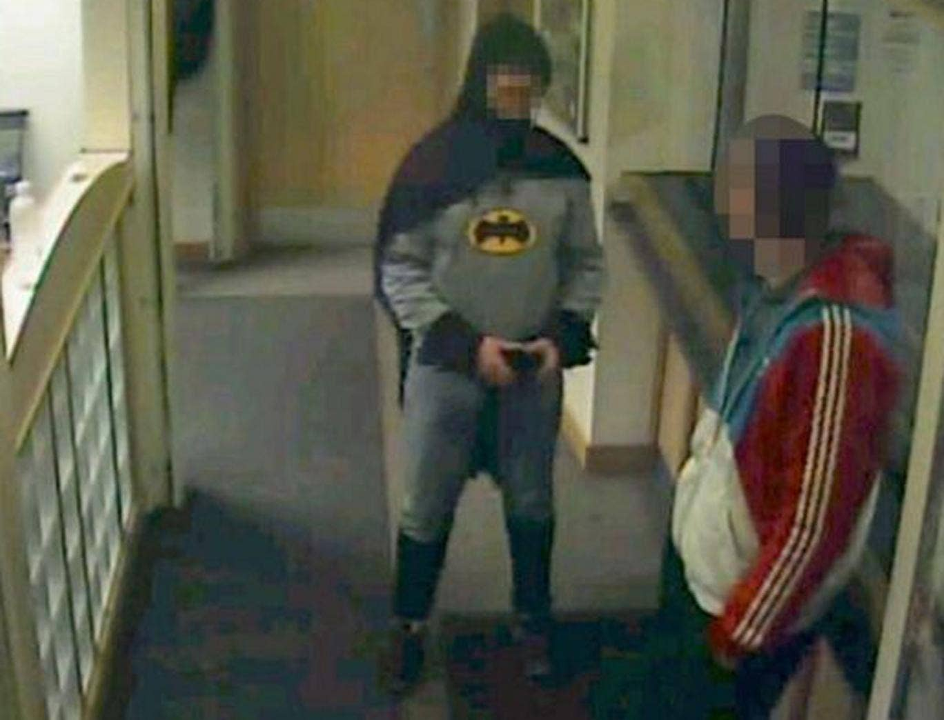 A man dressed as Batman marches a suspected fraudster to a police station in Bradford