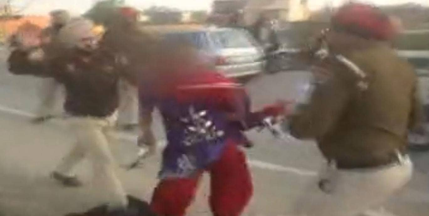 Officers appear to have used large sticks and their fists to brutally assault the 23-year-old