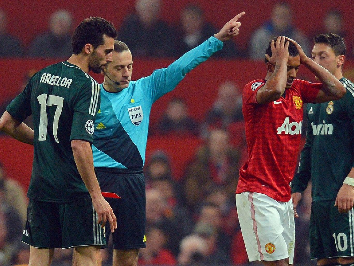 Cuneyt Cakir shows Nani a red card