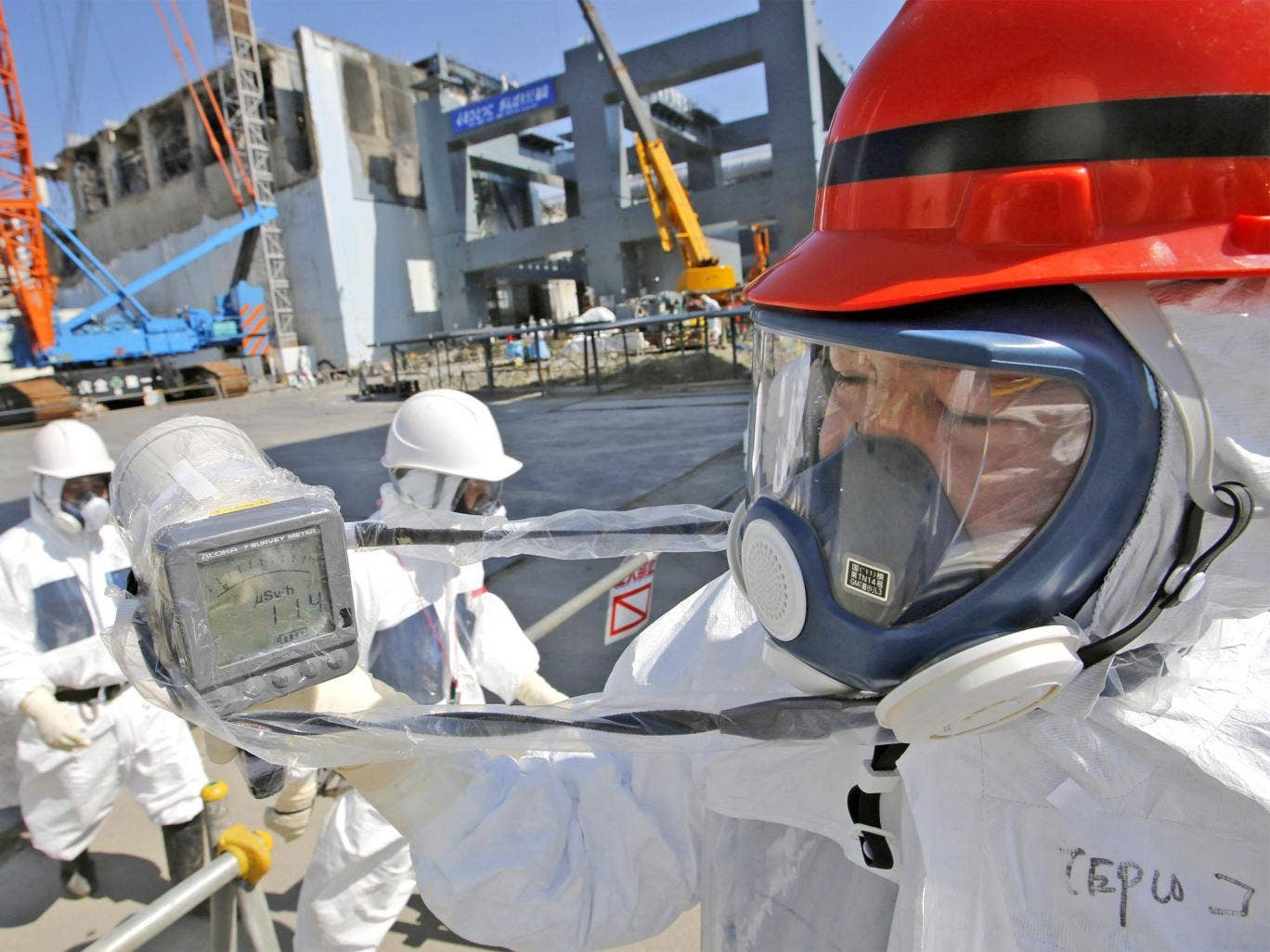 A radiation monitor indicates 114 microsieverts per hour near the building housing Fukushima's reactor unit four