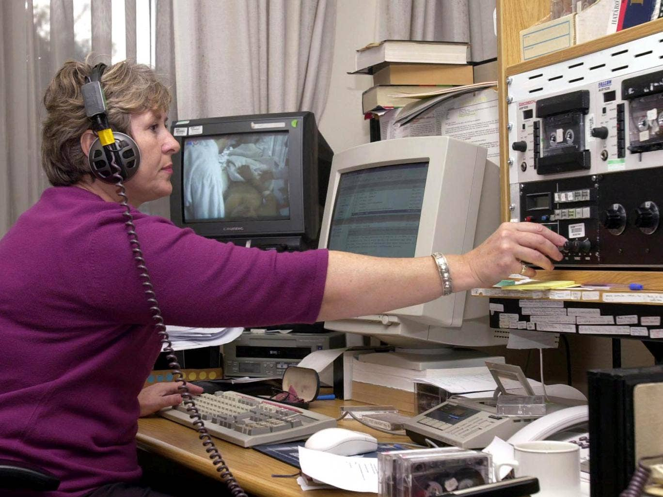 A BBC sub editor uses the old system at the BBC World Monitoring station, Caversham Park