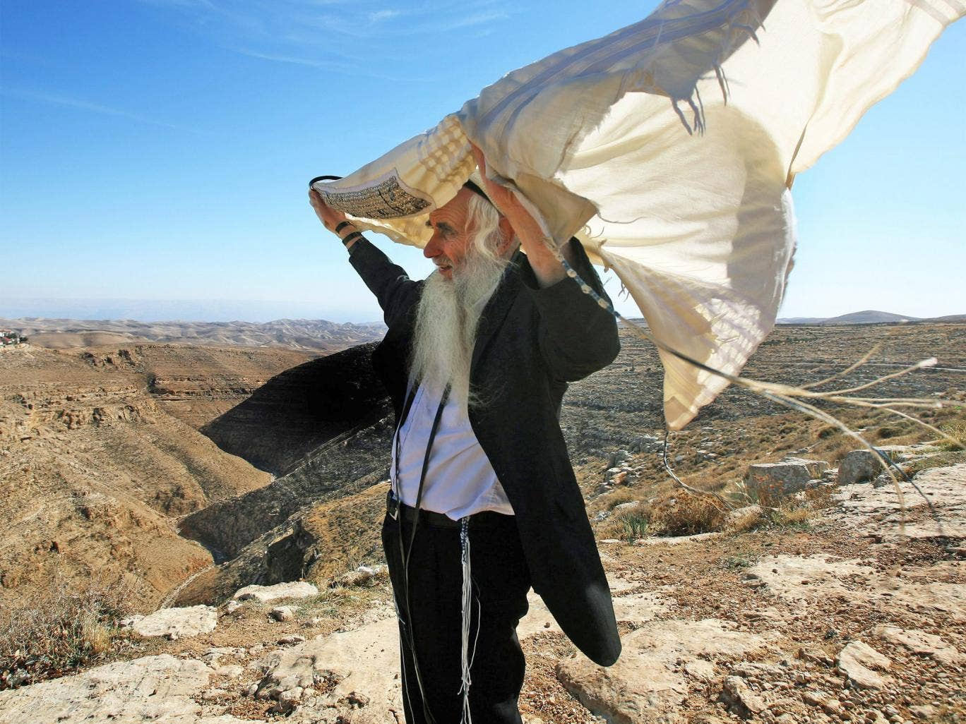 Rabbi Froman with his peace shawl caught in the wind