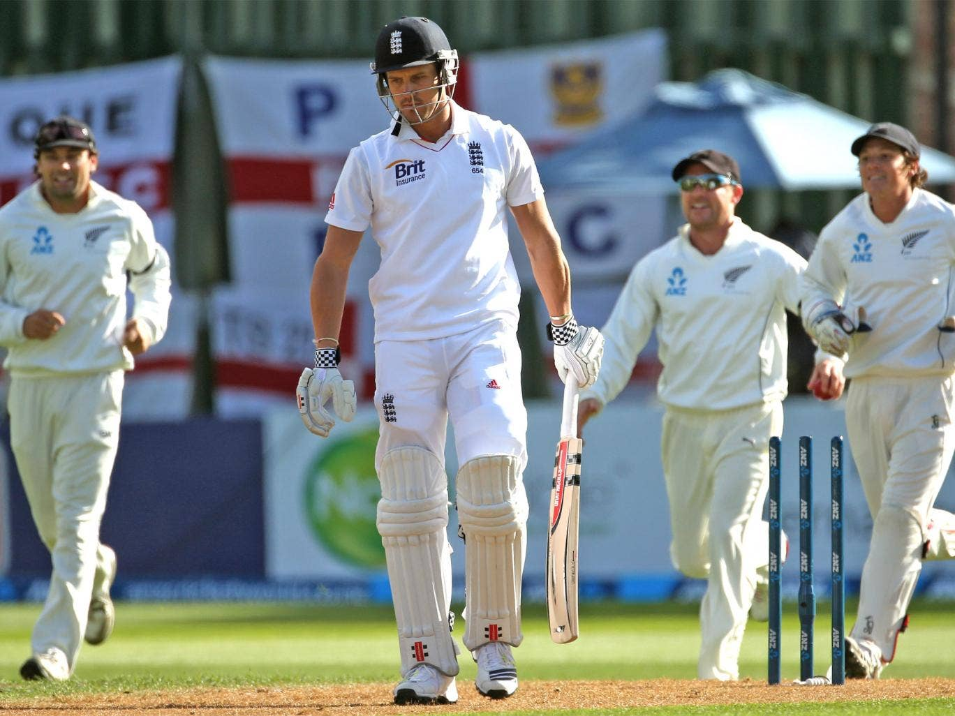 Nick Compton, of England, walks off the field after being bowled by Tim Southee, of New Zealand