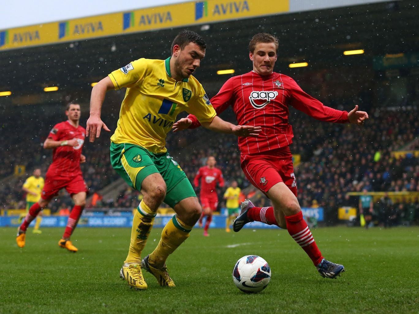 Robert Snodgrass of Norwich City battles with Luke Shaw of Southampton