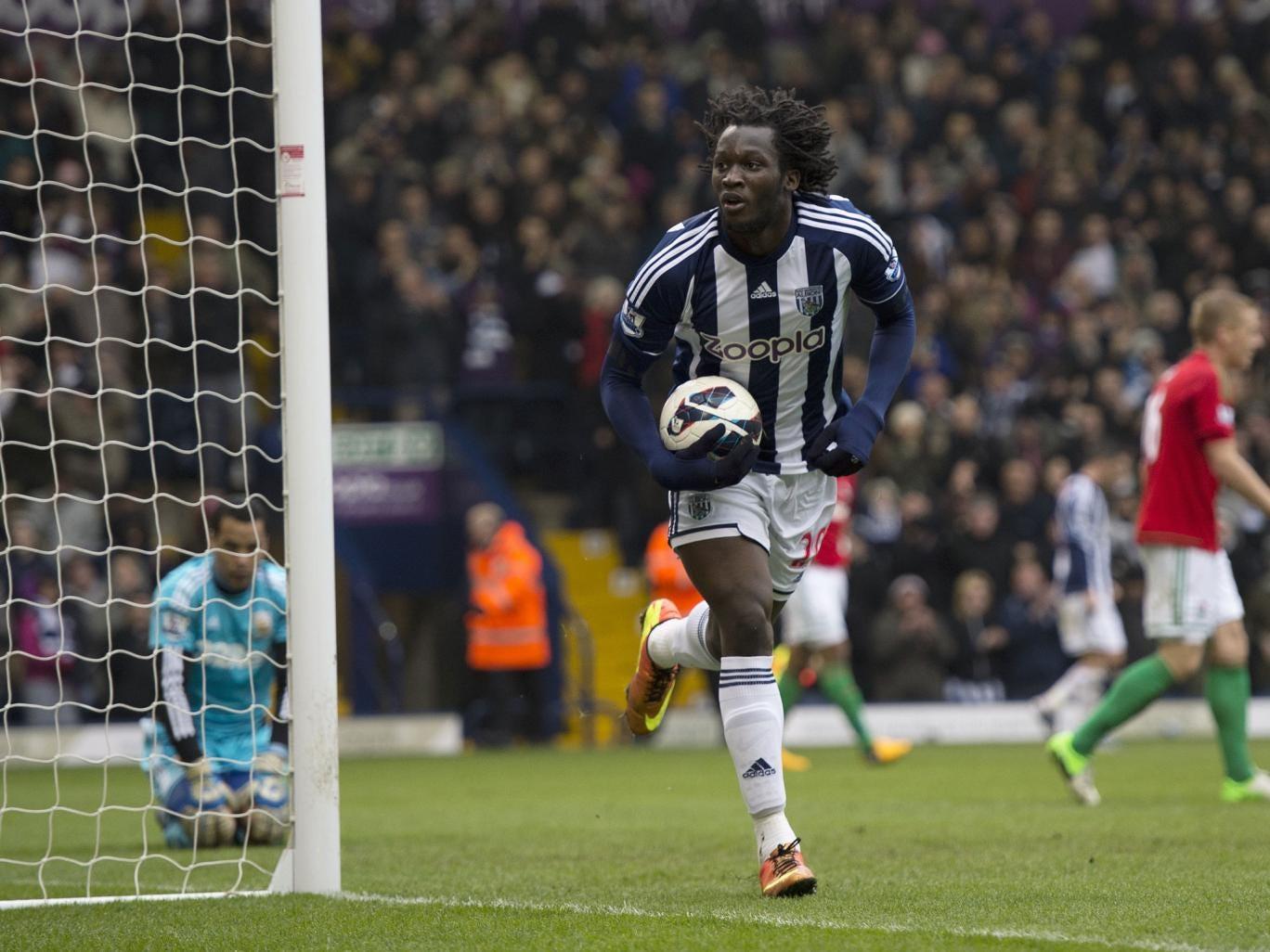 West Bromwich Albion's Belgian striker Romelu Lukaku (C) runs to celebrate after scoring