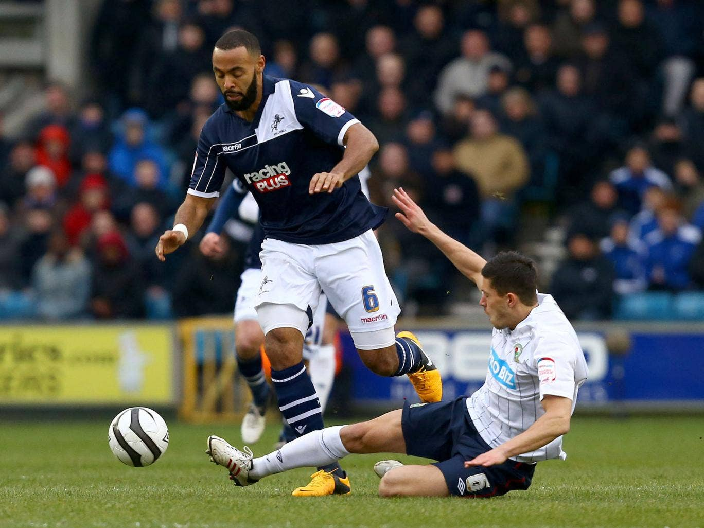 Jason Lowe of Blackburn Rovers slides in for a tackle on Liam Trotter of Millwall