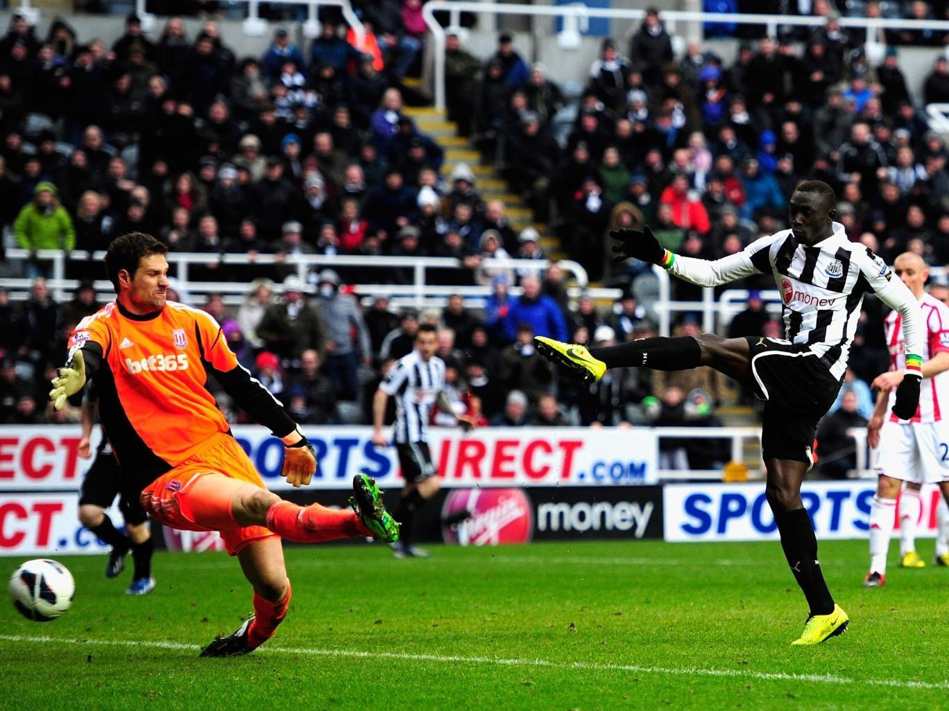 Stoke keeper Asmir Bergovic is beaten by Newcastle forward Papiss Cisse