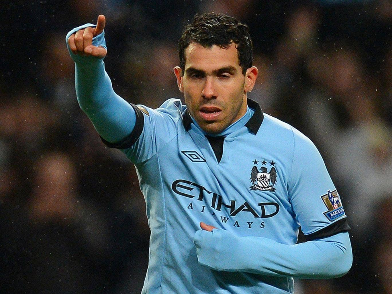 Manchester City's Argentinian forward Carlos Tevez celebrates after scoring his team's fourth goal and his third to complete his hat-trick