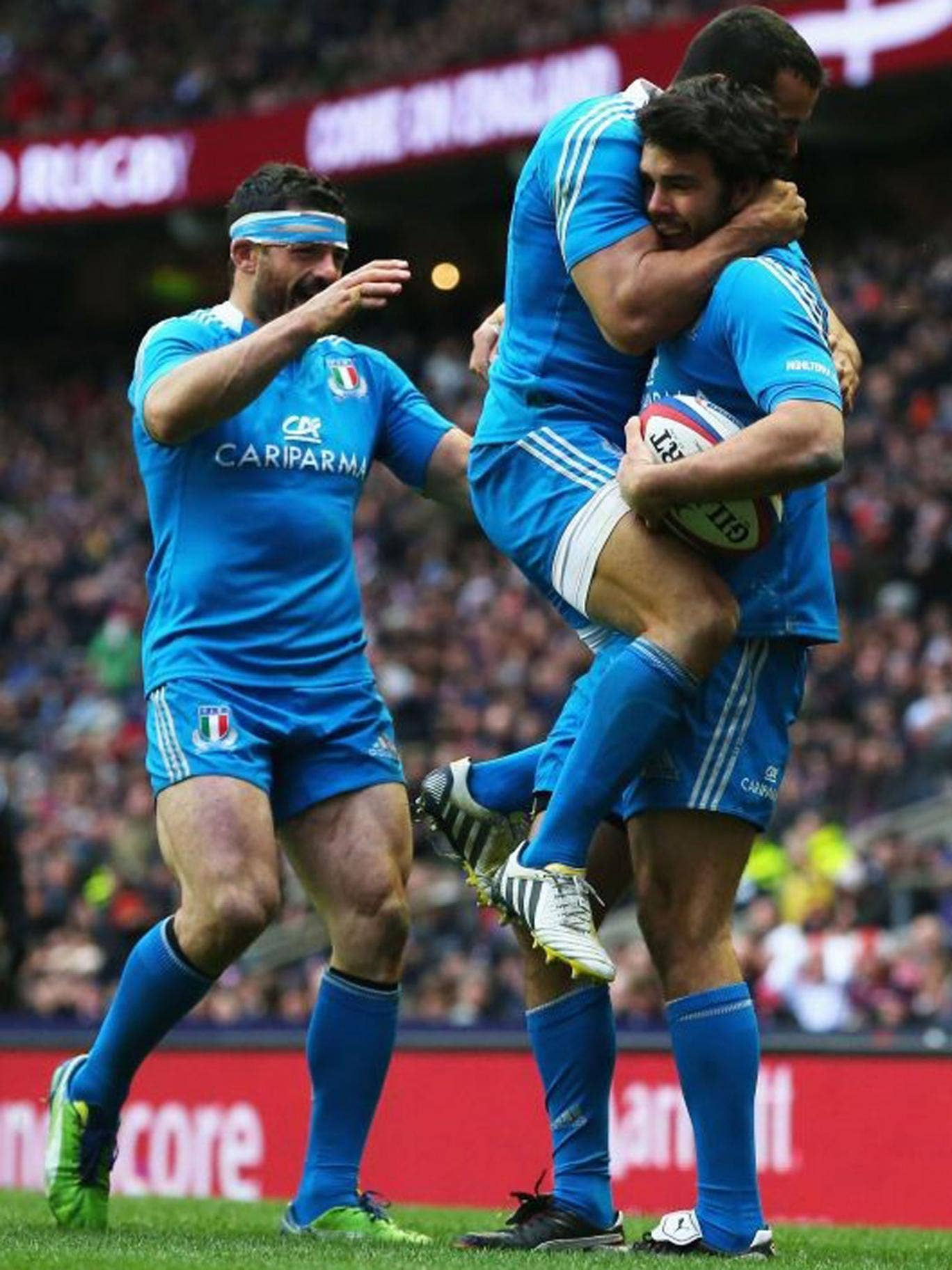 Tom McLean (far right) celebrates his try with Italy team-mates