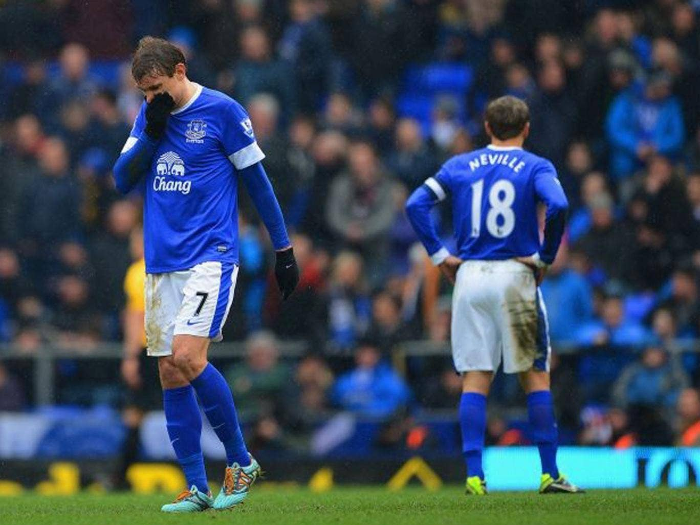 Nikica Jelavic (left) and Phil Neville during Everton's 3-0 defeat to Wigan