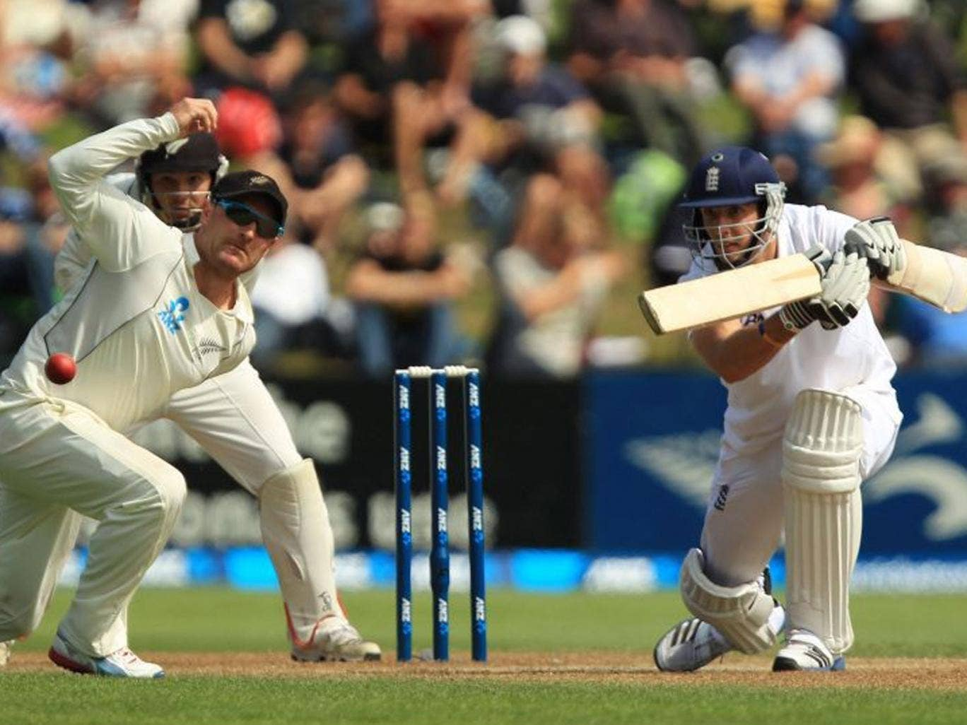 Steve Finn drives the ball past the New Zealand captain, Brendon McCullum, during his marathon innings