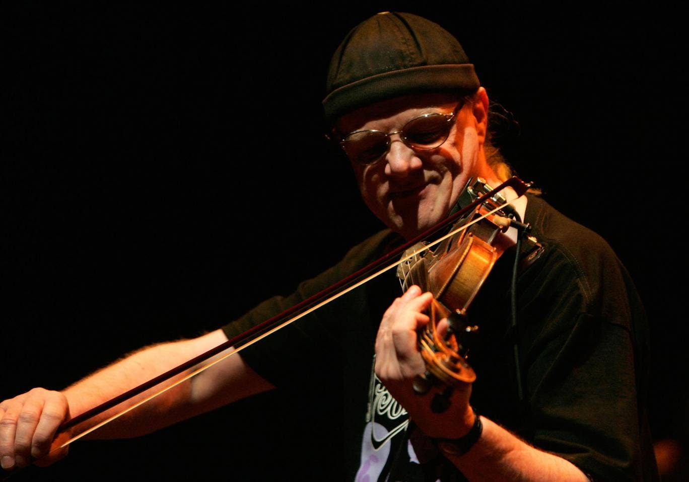 Violinist Richard 'Ric' Sandersof English folk band Fairport Convention perform live on stage