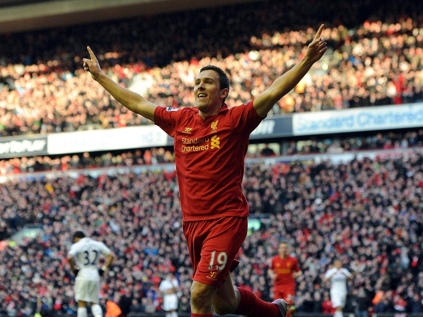Stewart Downing of Liverpool celebrates after scoring against Spurs