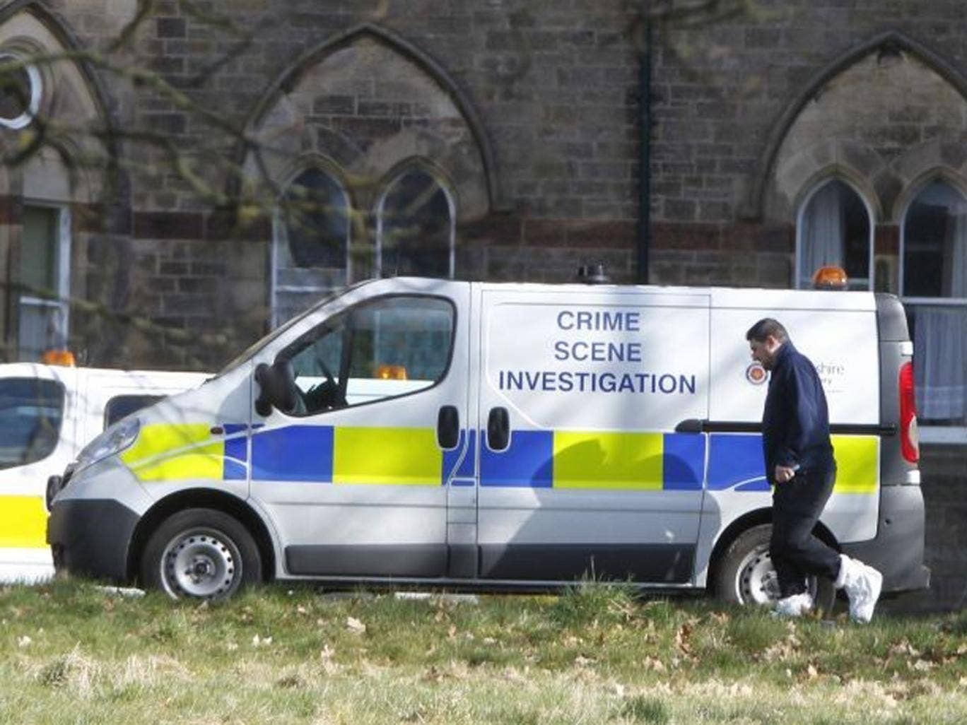 A view of  CSI vans at the Jamea Al Kauthar school in Lancaster, following the arrests of three men over claims of sexual assault and false imprisonment