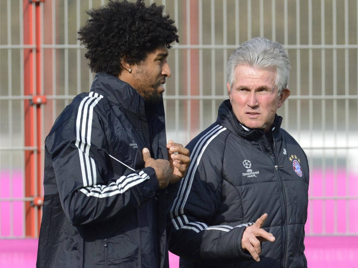 Jupp Heynckes chats with defender Dante in Munich