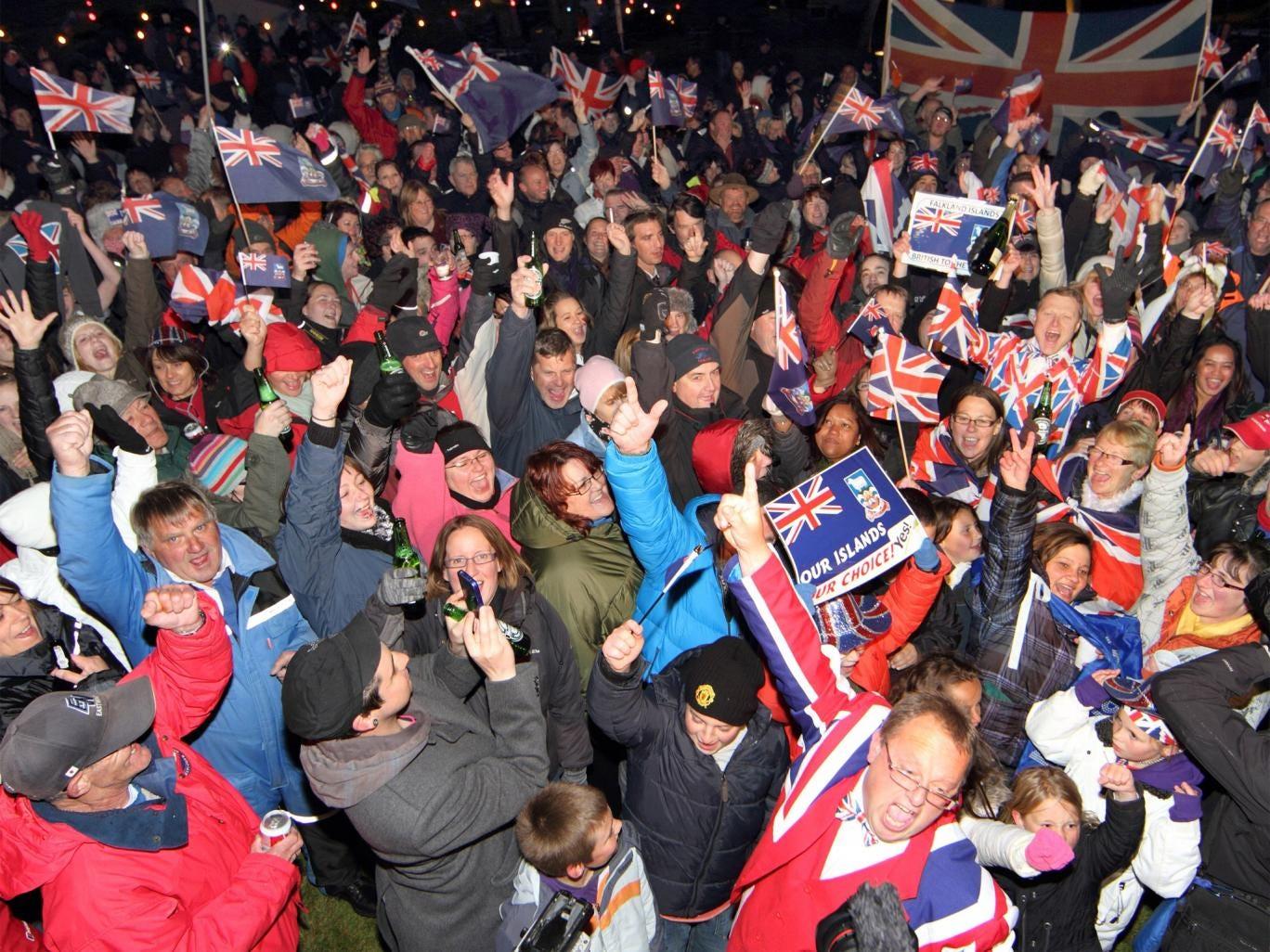 Falklanders celebrate the referendum result in Port Stanley on Monday night