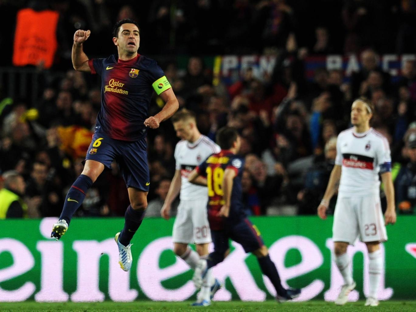 Xavi in action against AC Milan