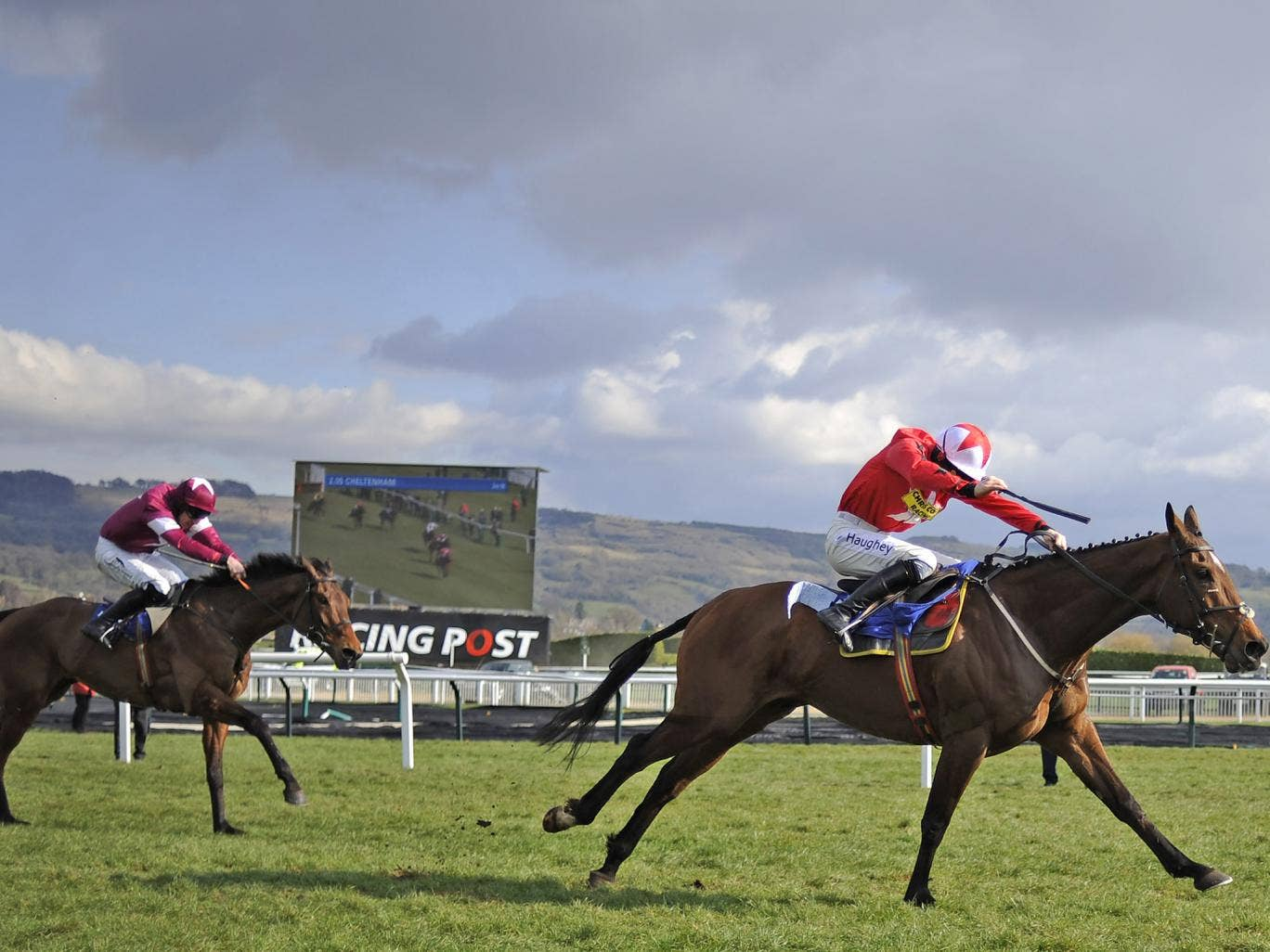 Sam Twiston-Davies rides The New One clear the last to win The Neptune Investment Management Novices' Hurdle Race