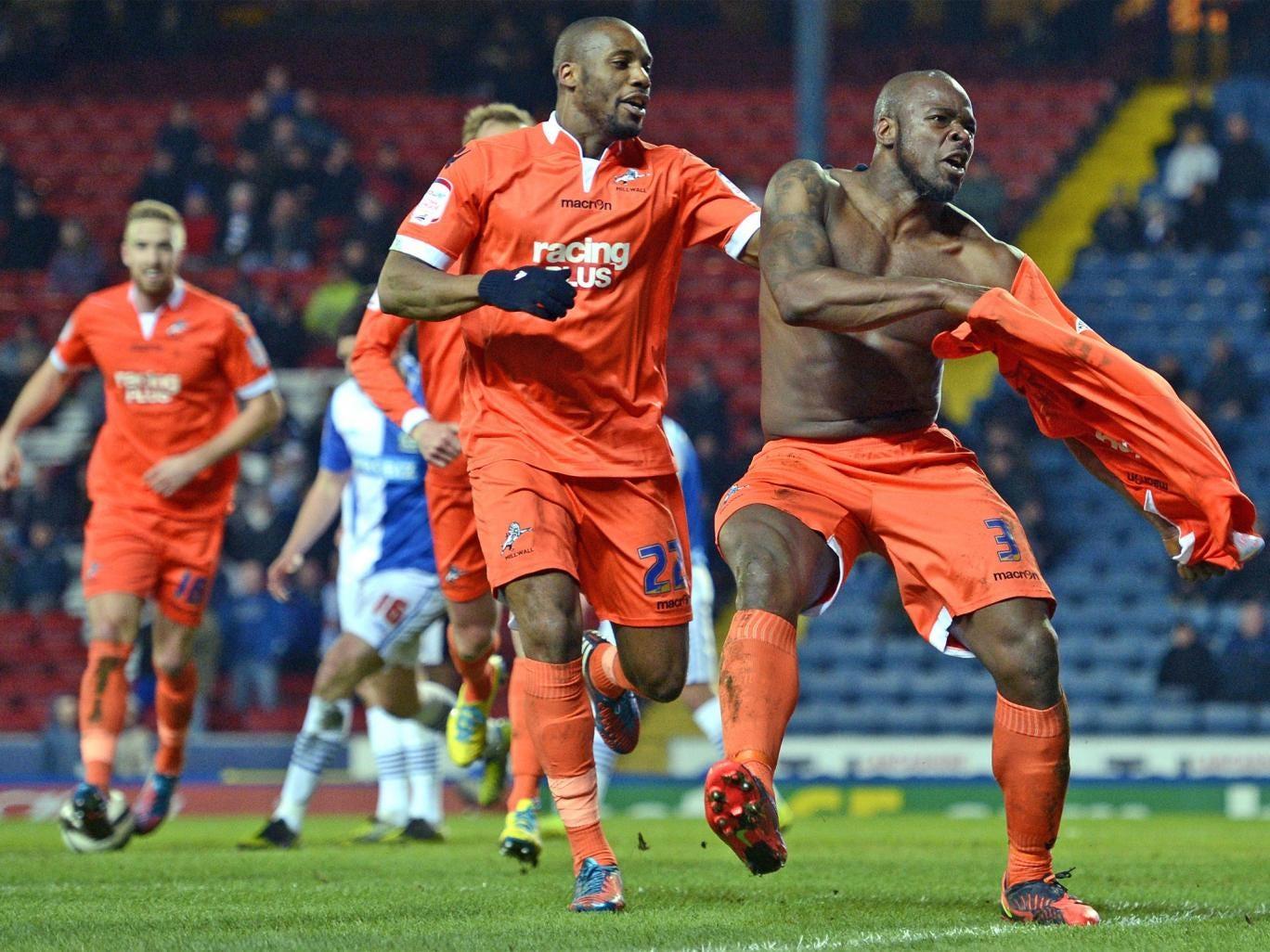 The Millwall captain, Danny Shittu, celebrates his winning goal