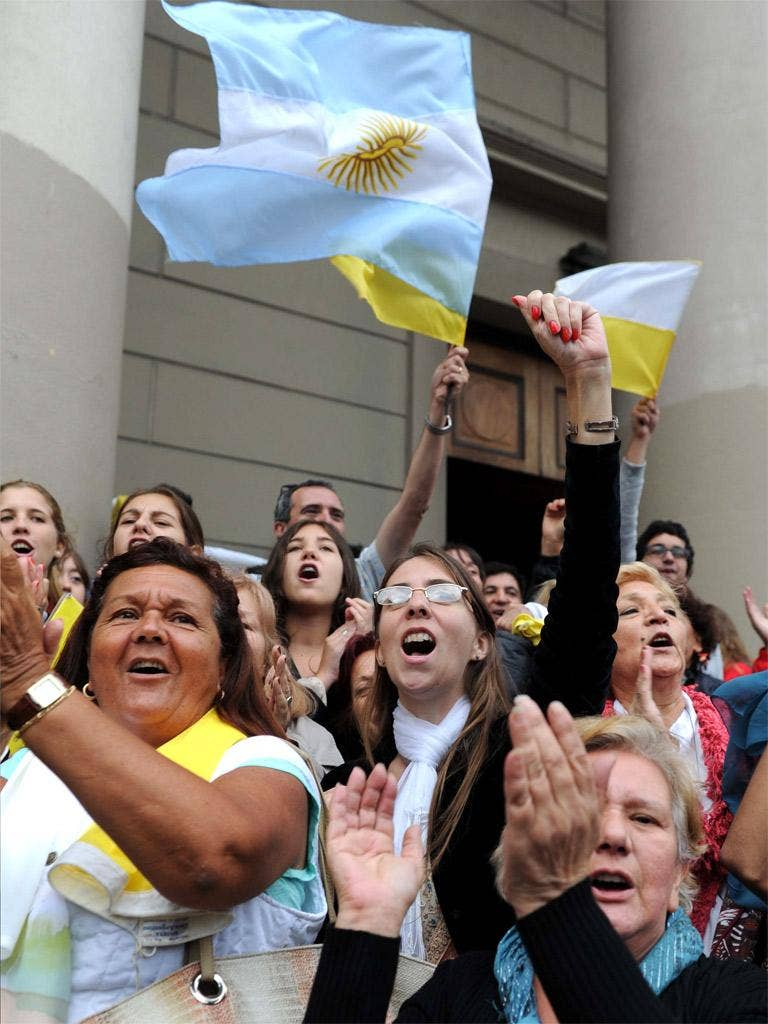 Argentine faithful celebrate outside a cathedral in Buenos Aires