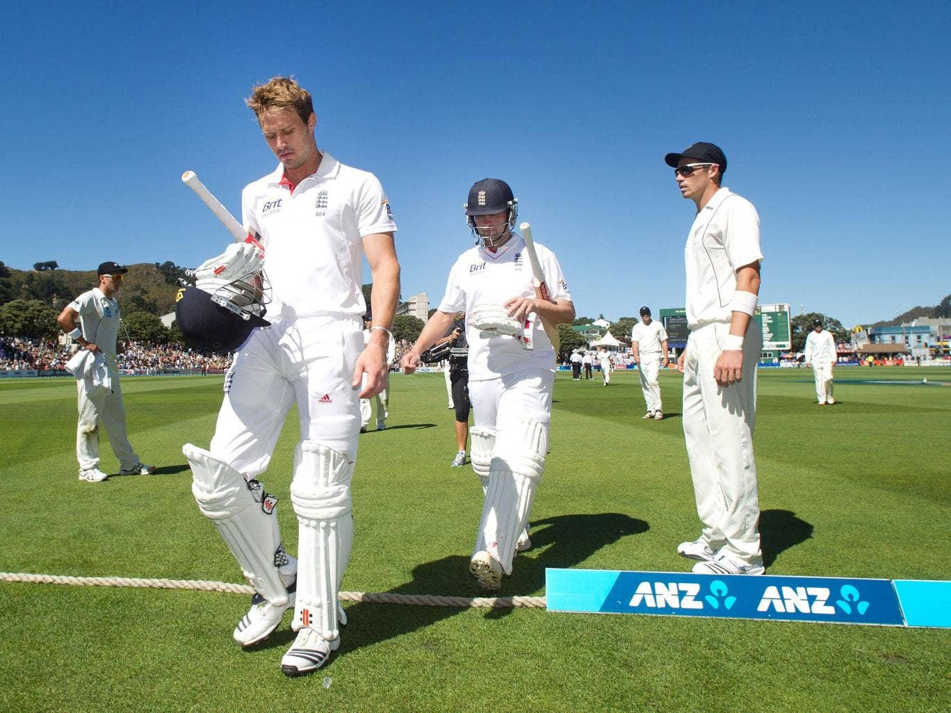 Jonathan Trott and Nick Compton leave the field of play after the first day of the second Test between England and New Zealand