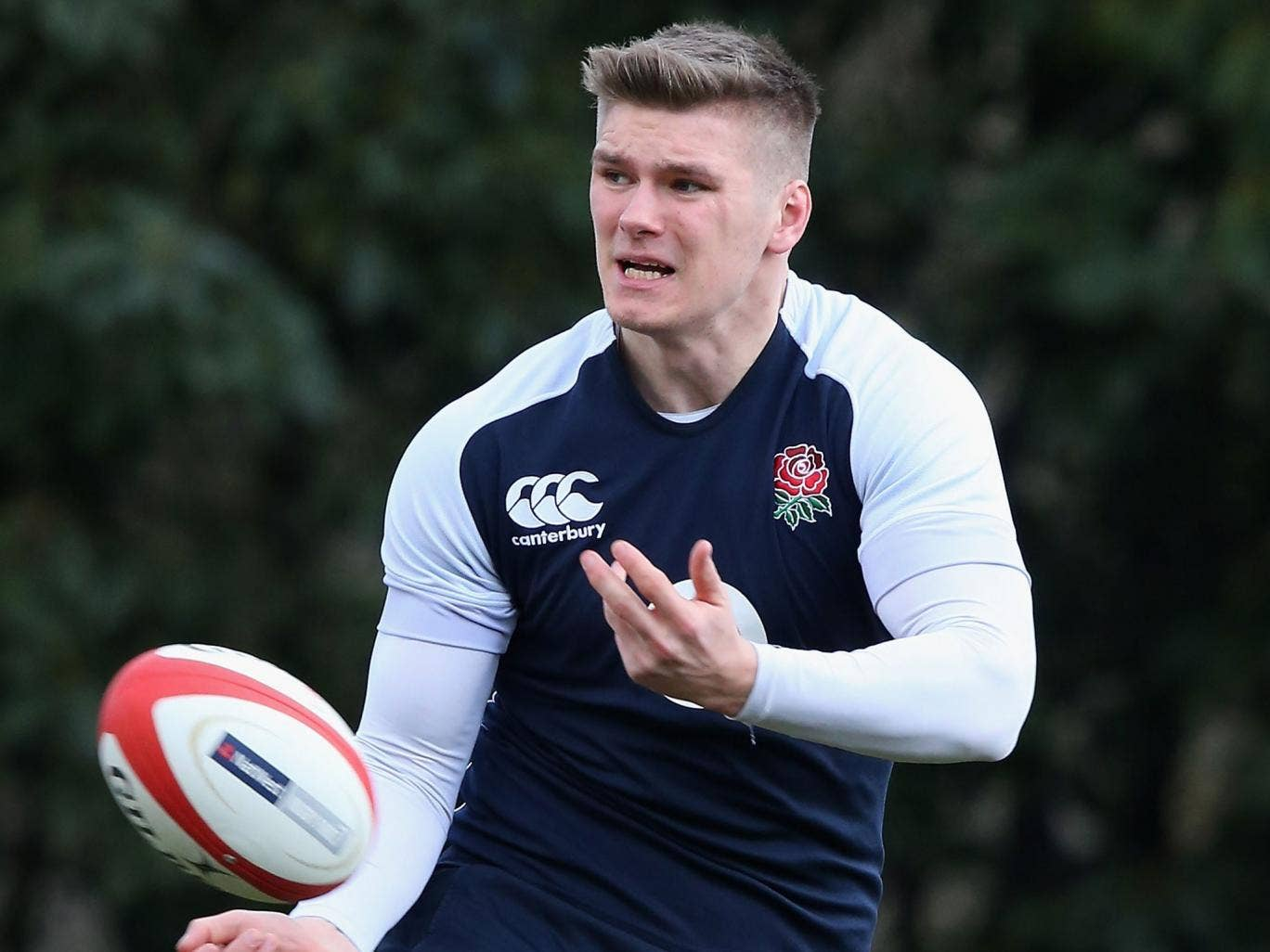 Owen Farrell passes the ball during England training at Pennyhill Park