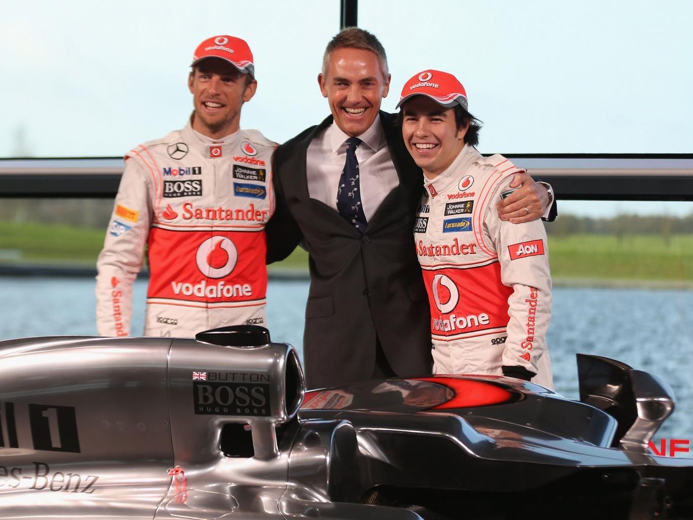 McLaren Mercedes Formula 1 drivers Jenson Button (L) of Great Britain and Sergio Perez (R) of Mexico