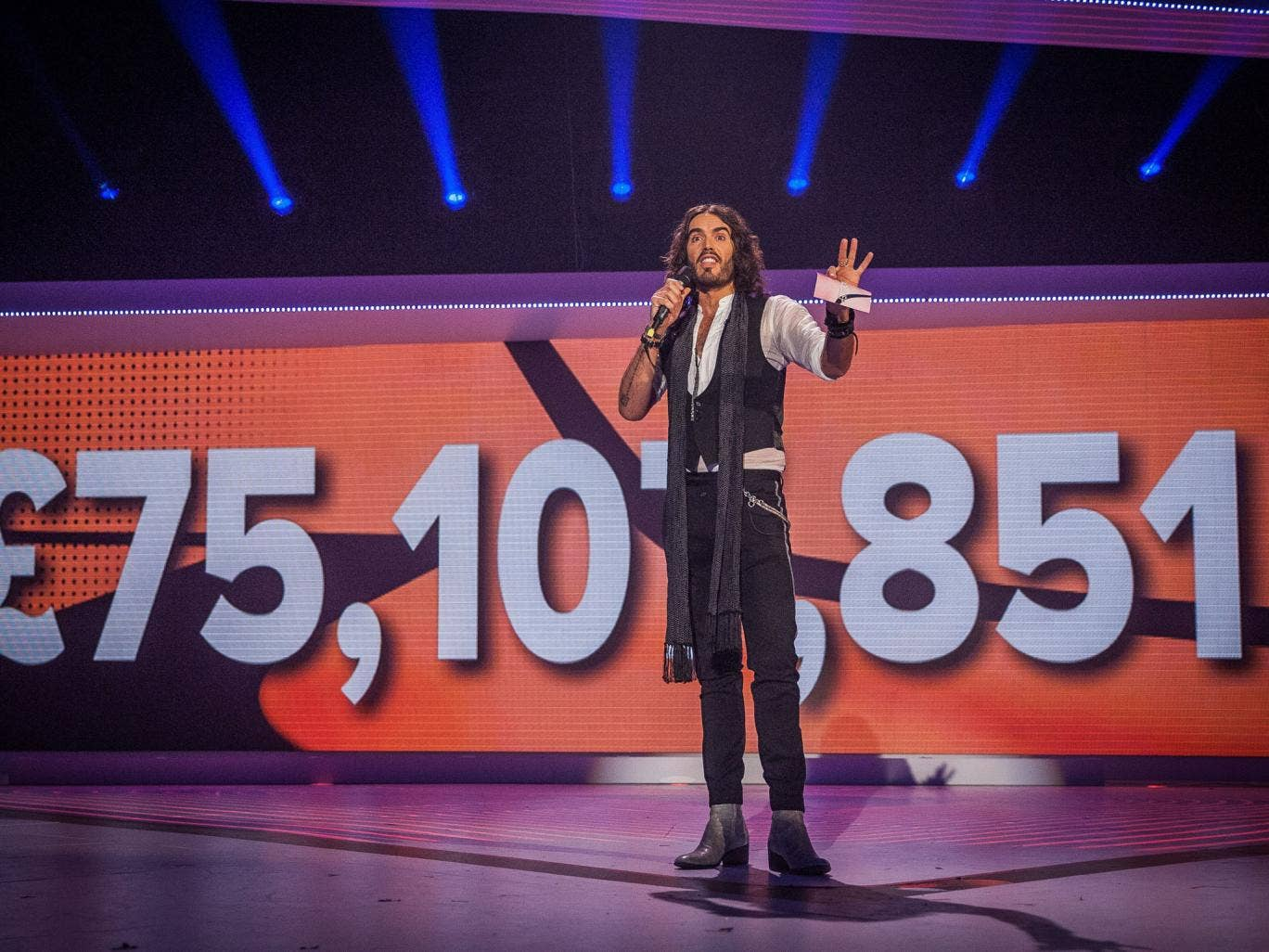 In the money: Russell Brand shows off a record-breaking tally