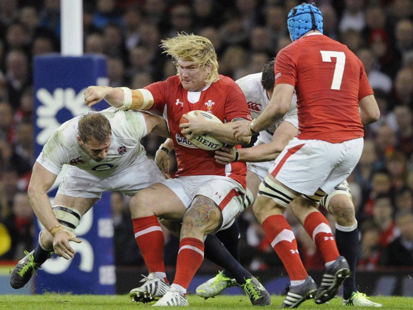 Captain crunch: Chris Robshaw (left) leads by example with a tackle on the Wales hooker Richard Hibbard