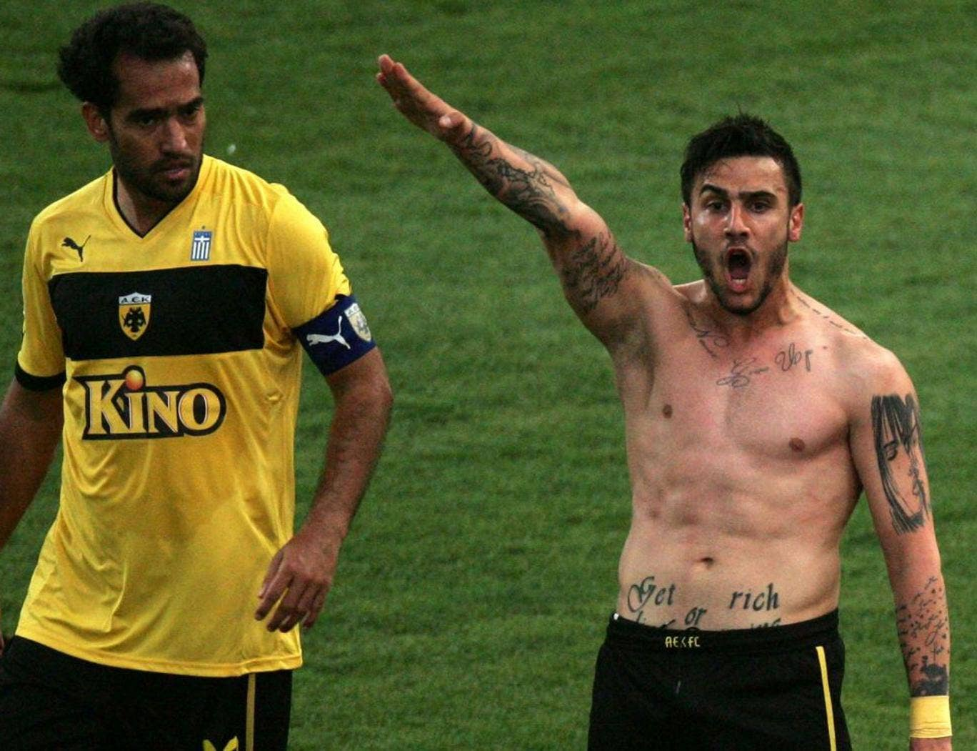 Giorgos Katidis gives what appears to be a fascist salute after scoring his side's winning goal against Veria, as his Brazilian team mate Roger Guerreiro looks on