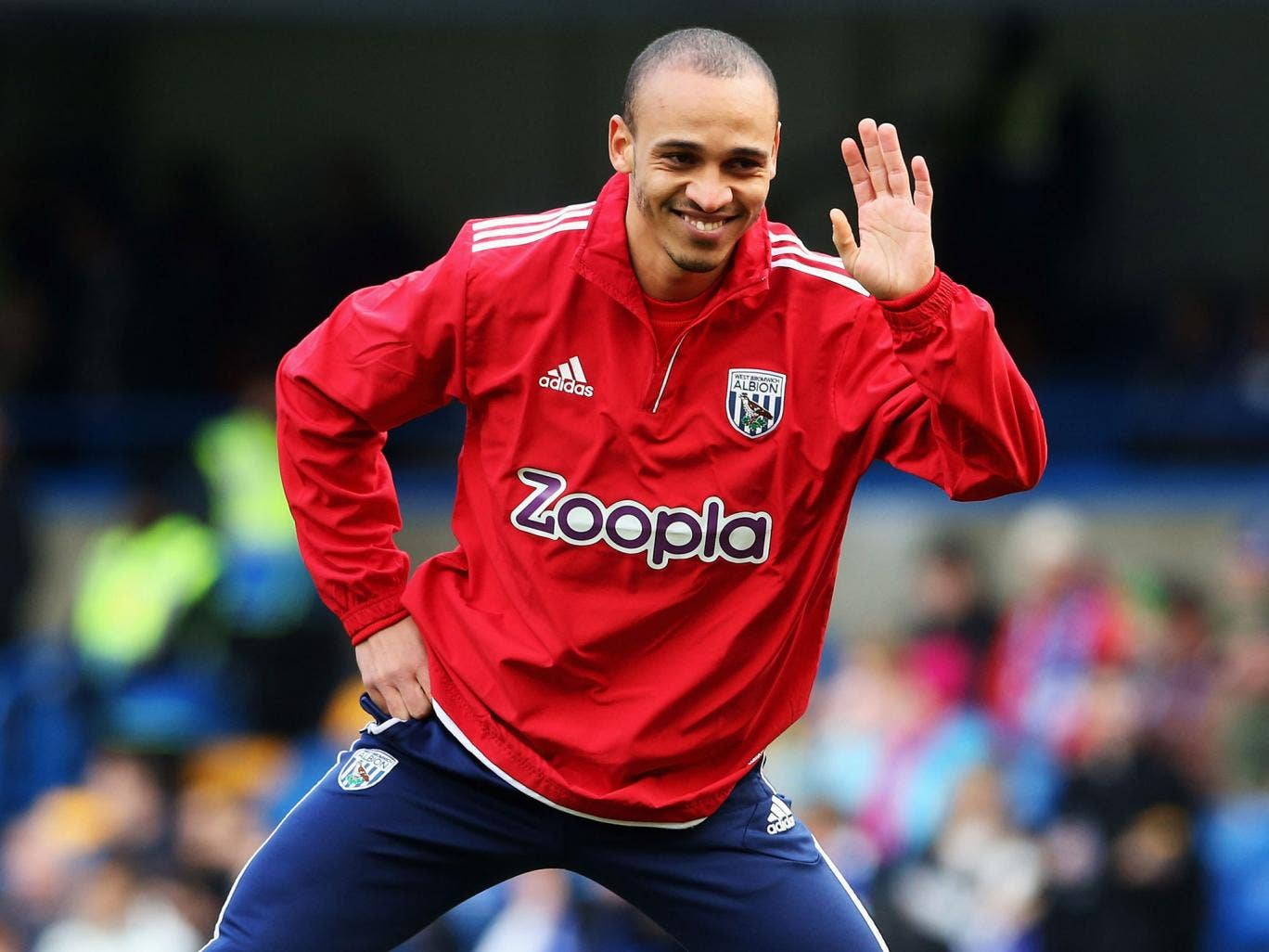 Peter Odemwingie of West Bromwich Albion waves as he warms up prior to the Barclays Premier League match between Chelsea and West Bromwich Albion