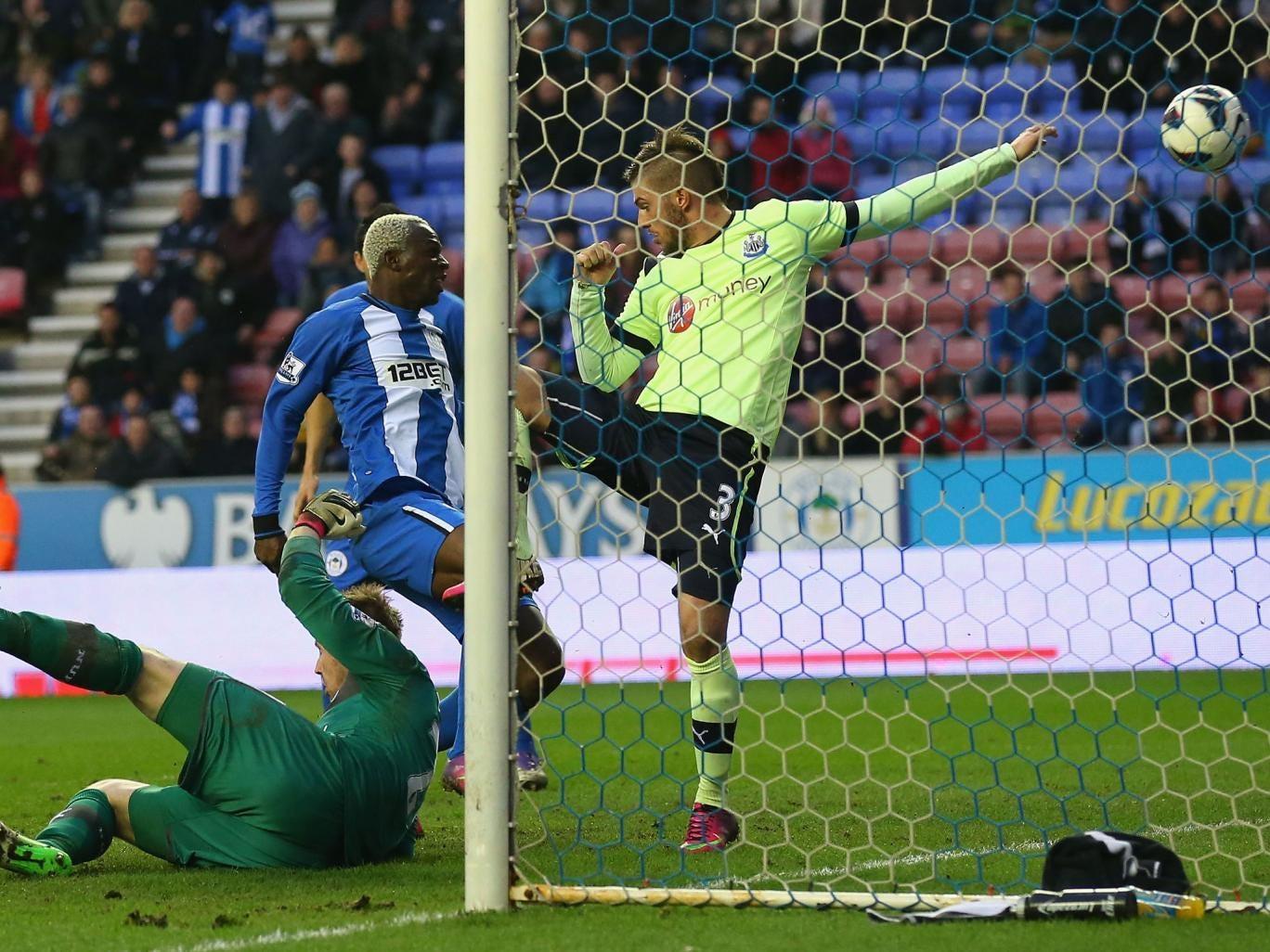 Arouna Kone of Wigan Athletic scores the winning goal