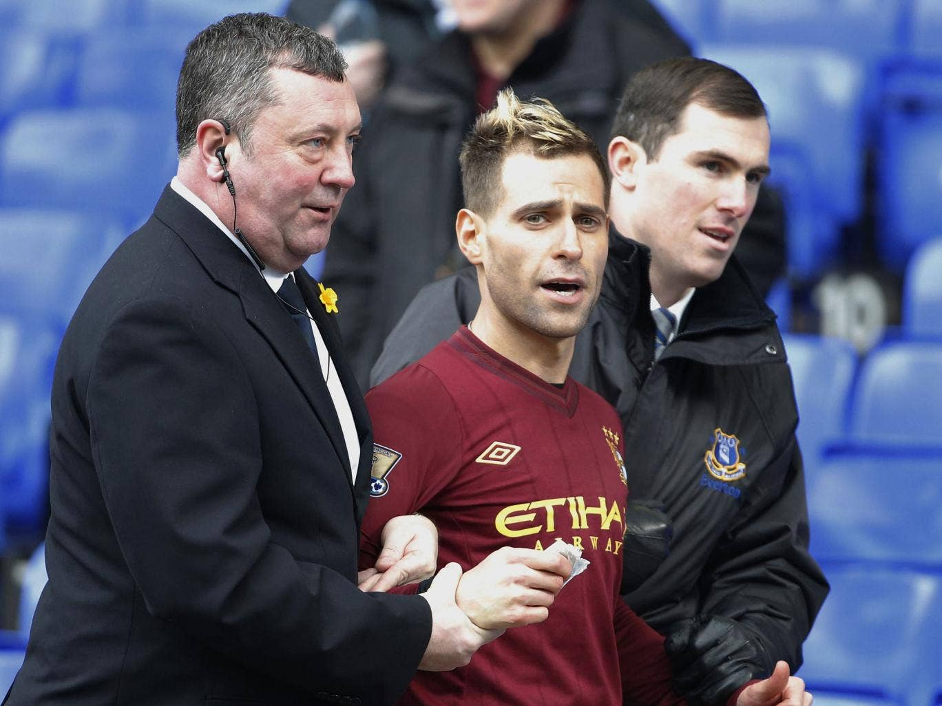 Jason Bent, Simon Brodkin's spoof footballer, being taken off the pitch