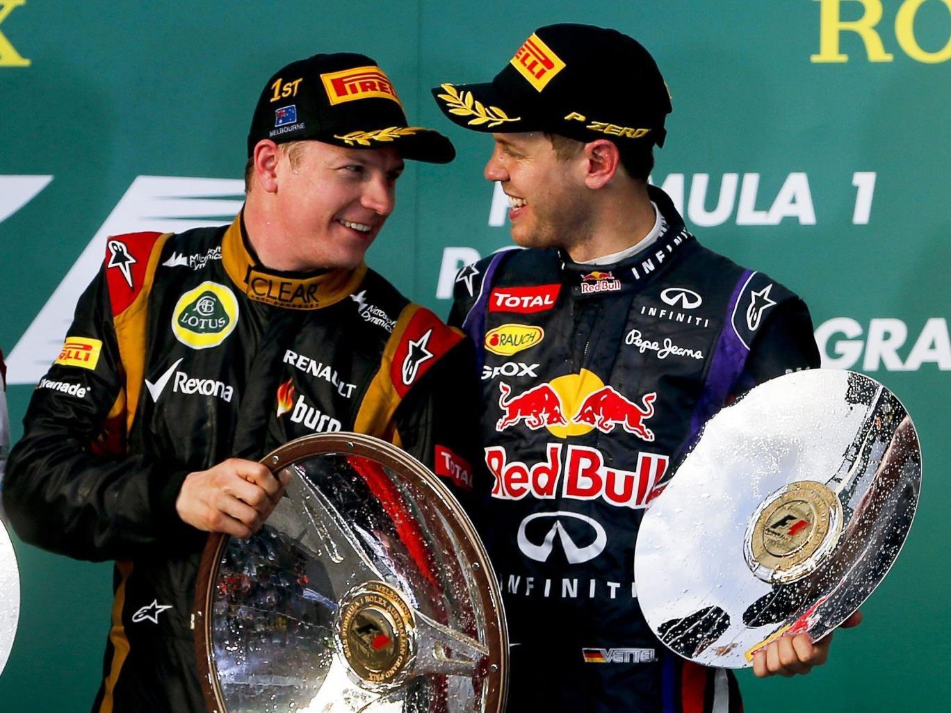 Kimi Raikkonen (left) chats to Sebastian Vettel after winning the opening grand prix of the season in Melbourne yesterday