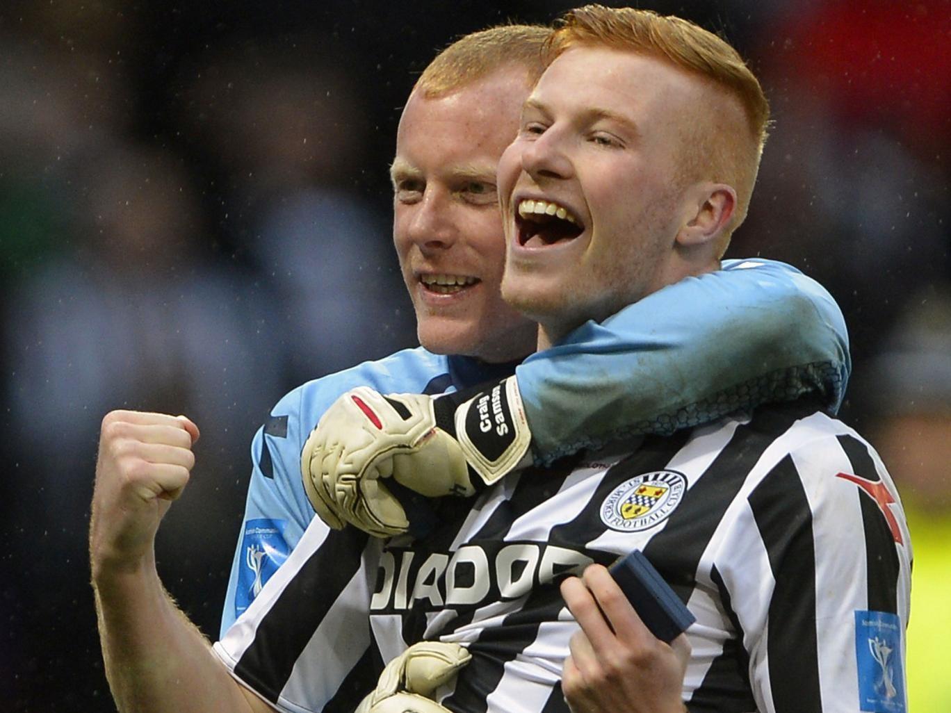 Scorer Connor Newton (right) celebrates with Craig Samson