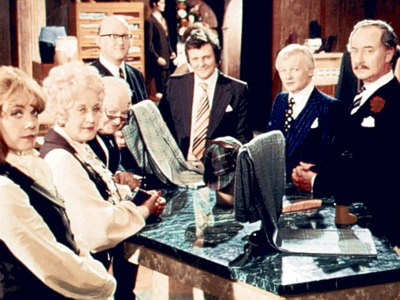 Thornton, far right, with the staff at Grace Brothers; although he was typecast as Captain Peacock, he never regretted taking the role