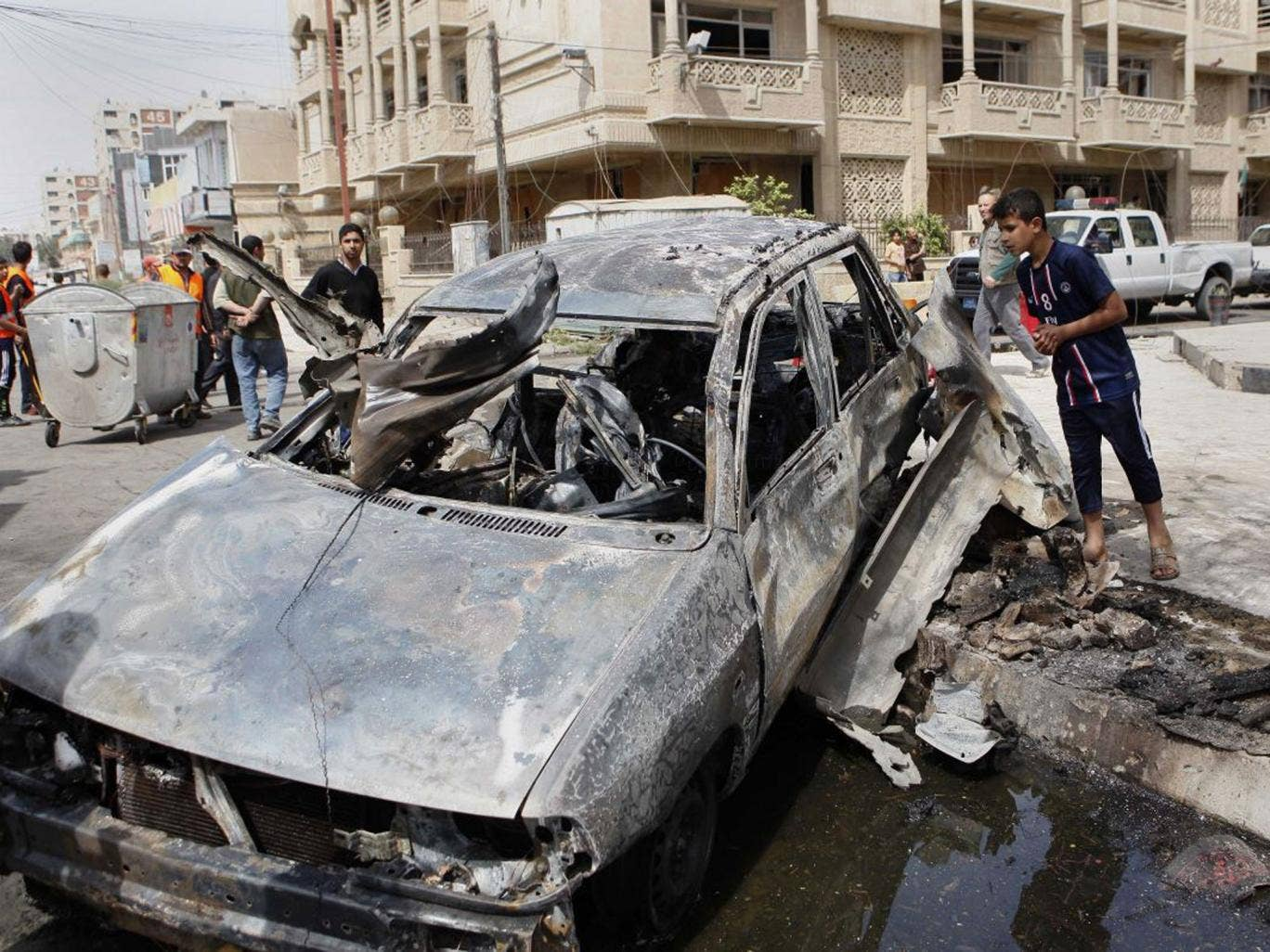 A car destroyed in an attack close to the Green Zone in Baghdad