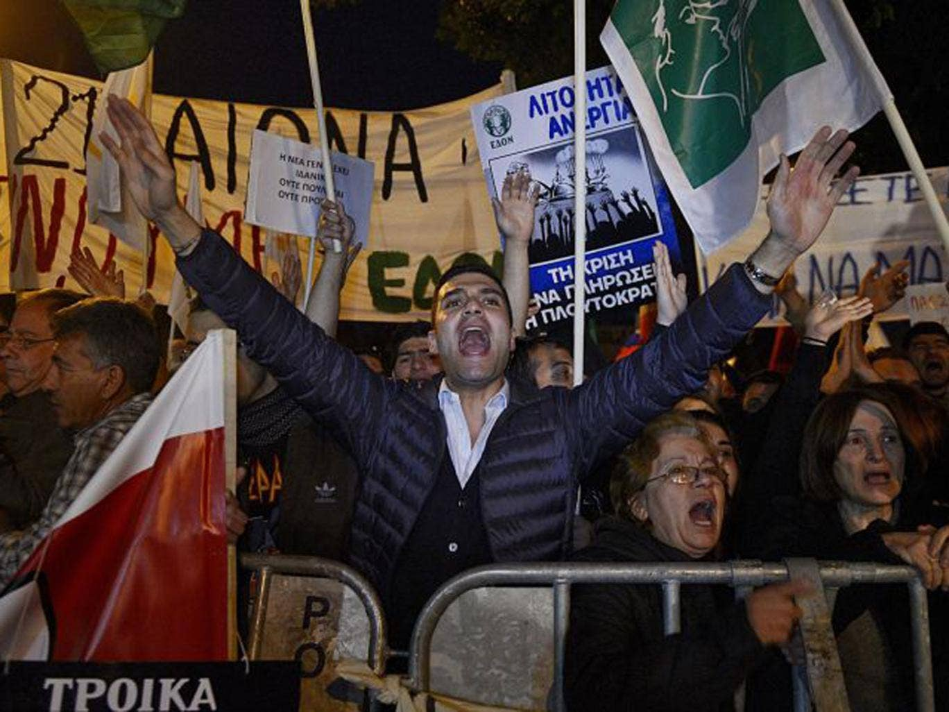 Protestors shout slogans during a rally against a tax levy on deposits