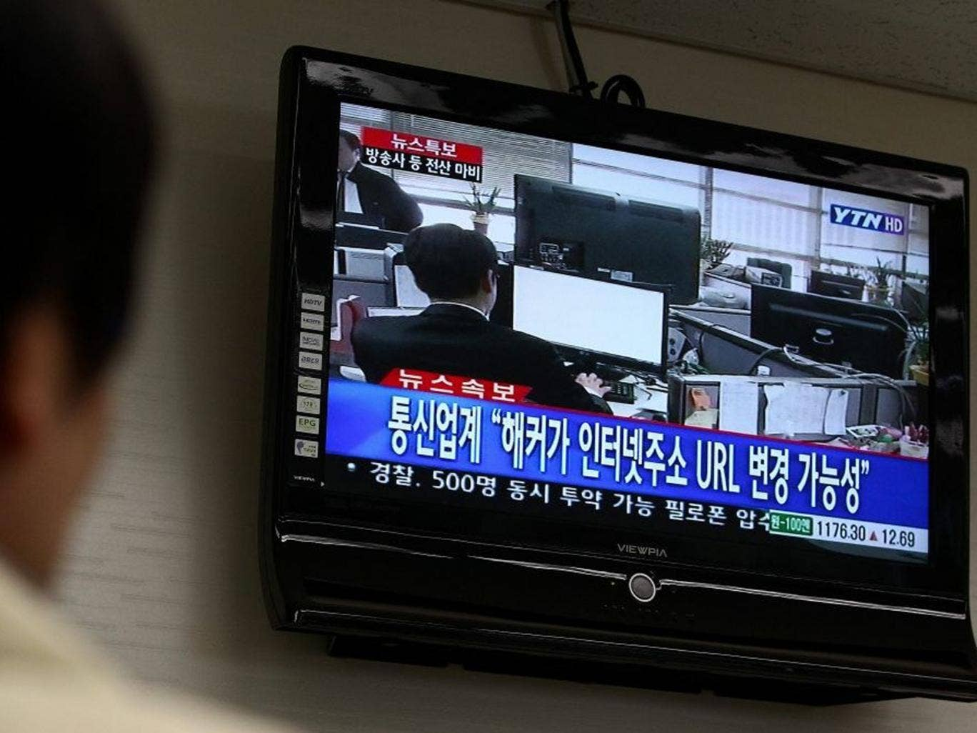 A man watches breaking news on computer failures, in Seoul, South Korea