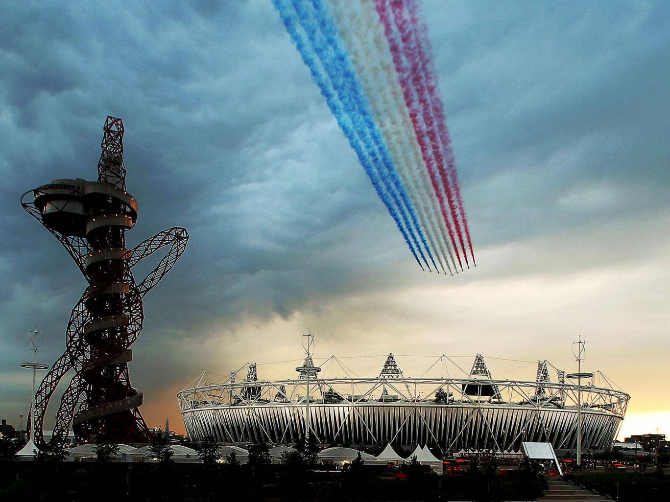 The Red Arrows fly over Olympic Stadium during the Opening Ceremony for the 2012 Summer Olympic Games