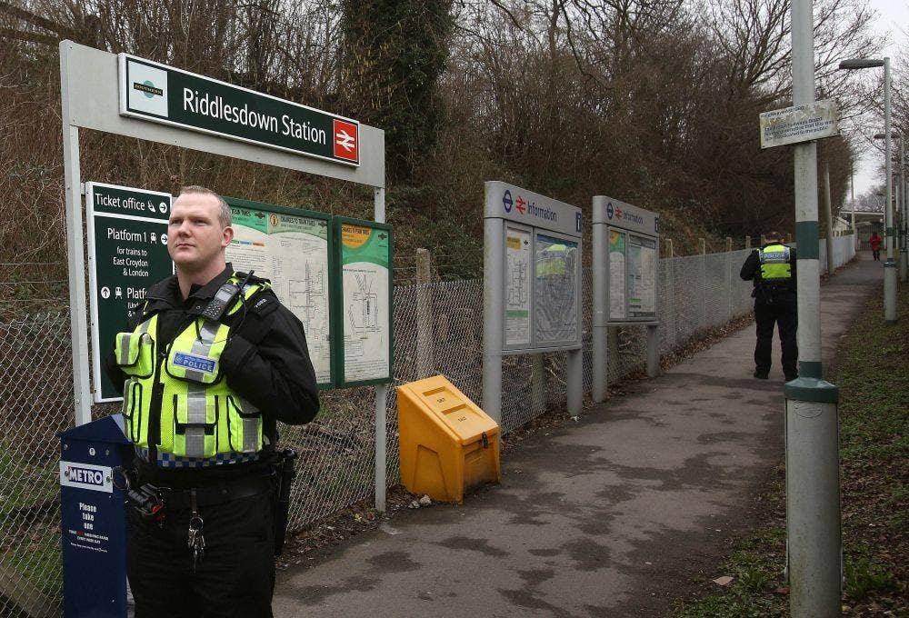 Police at Riddlesdown railway station near Purley, South London where a woman and a young boy, believed to be three years old, died today when they were hit by a main line train in the morning rush hour