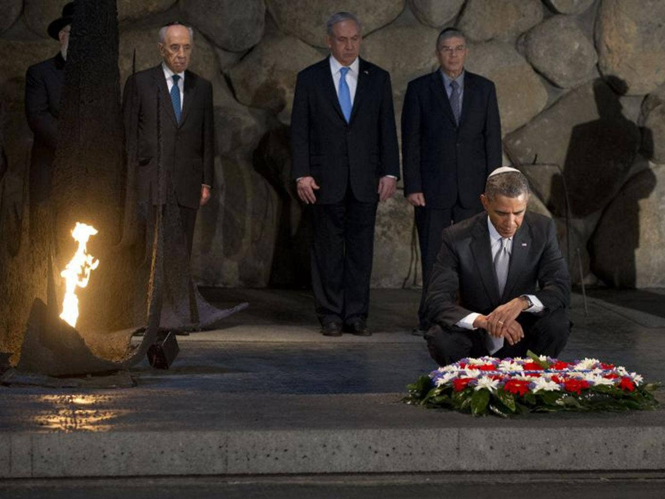 Barack Obama lays a wreath in the Hall of Remembrance at the Yad Vashem Holocaust Museum
