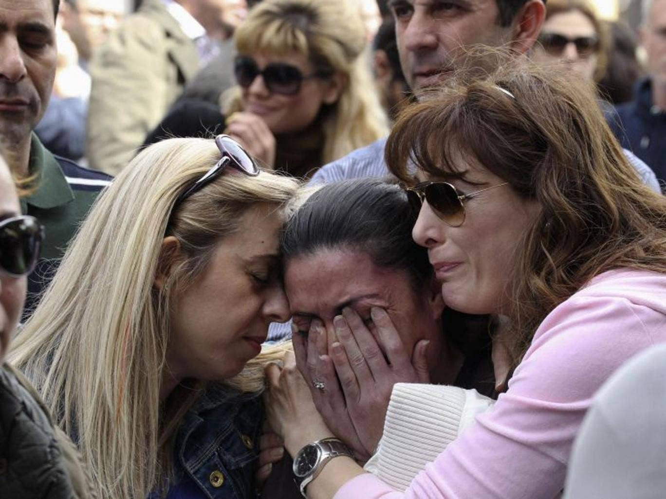 A protester cries at an anti-bailout rally by Cyprus Popular Bank staff