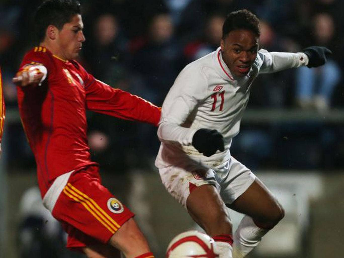Raheem Sterling is challenged during the 3-0 win over Romania