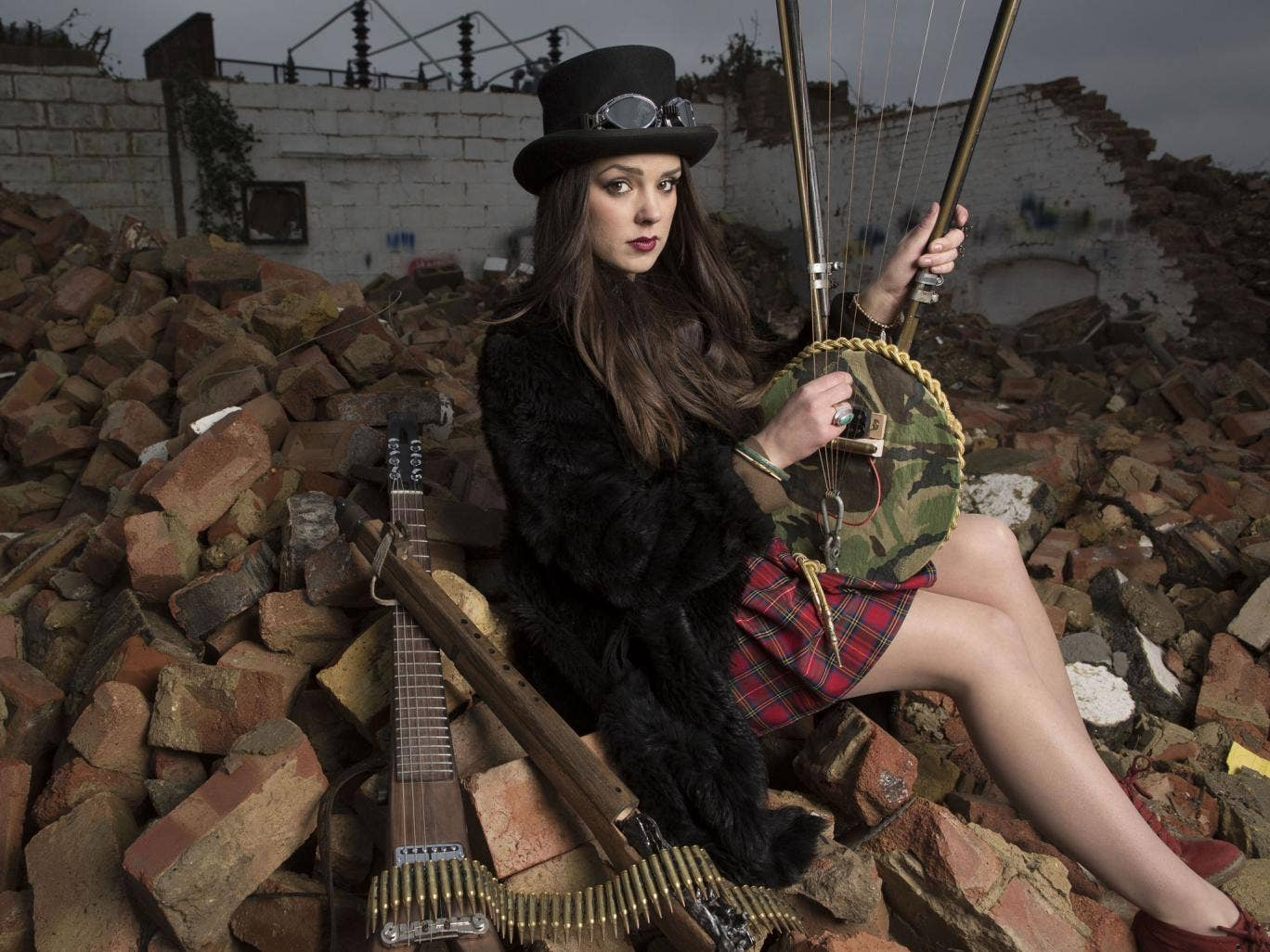 Second wind: Musician Ruby Fenn plays a lyre made from a Second World War helmet