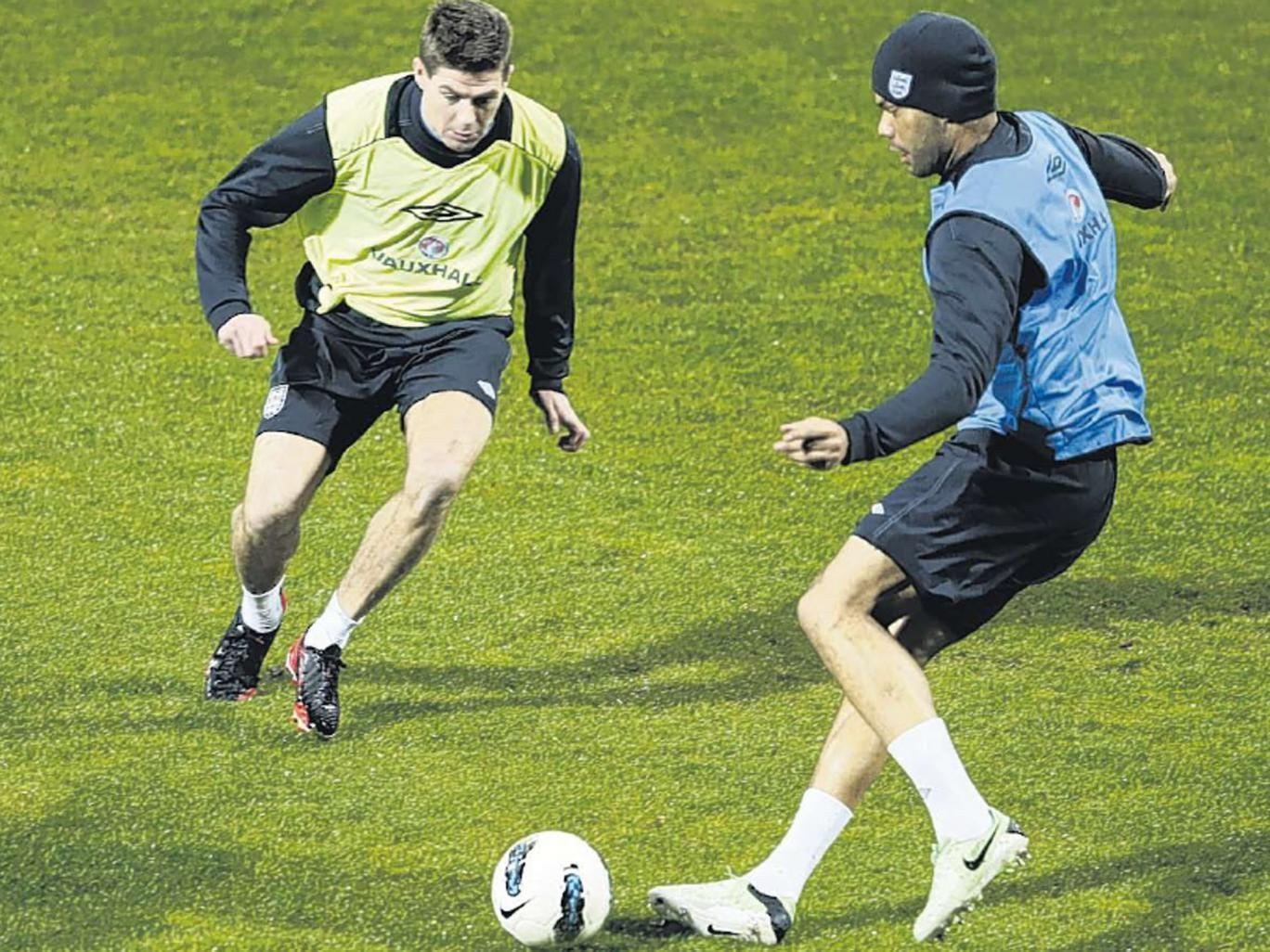 Steven Gerrard (left) and Joleon Lescott during training at the Podgorica City Stadium yesterday